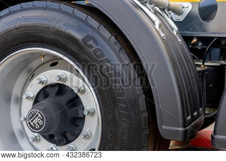 A Truck Wheel With A New Cordiant Tire Under A Plastic Fender. Close-up Of A New Tire On A Stamped S