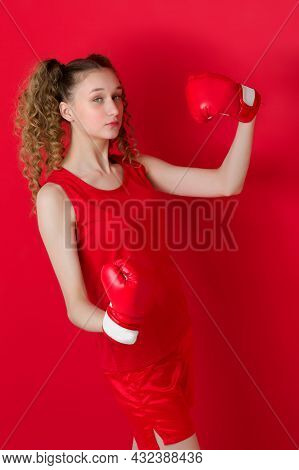 Sporty Girl Raising Her Hand While Celebrating Triumph. Beautiful Confident Girl With Two Curly Pony