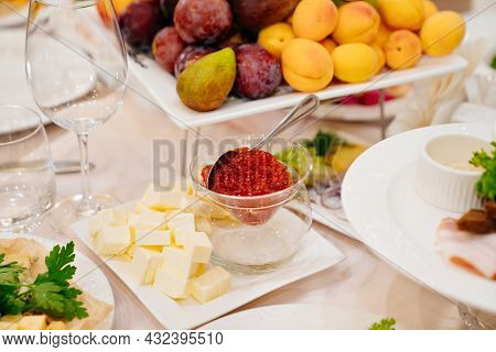 A Bowl Of Red Caviar And Butter On The Dining Table. Delicacies For The Holiday