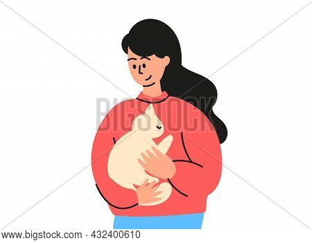 A Cute Dark-haired Girl Is Holding A Cat In Her Arms. A Domestic Cat, A Pet Is Sitting On His Hands.