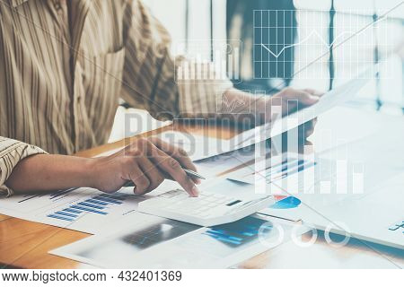 Close-up Of A Business Man Using A Calculator To Audit The Companys Budget. Tax Information Is Calcu