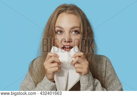Young Blond Woman Suffering From Allergy On Light Blue Background. Symptoms Of Cold Or Allergy. Woma