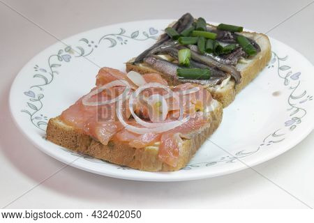 Sandwich Pair With Slices Of Salted Salmon And Sprats, On White Toast Bread With Butter, Seasoned Wi