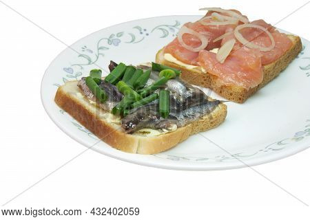 Sandwich Pair With Solted Fish: Slices Of Salted Salmon And Small Silvery Sprats, On White Toast Bre