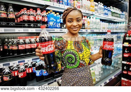 Kyiv, Ukraine - September,9 2021: African Woman With Coca-cola Beverages.