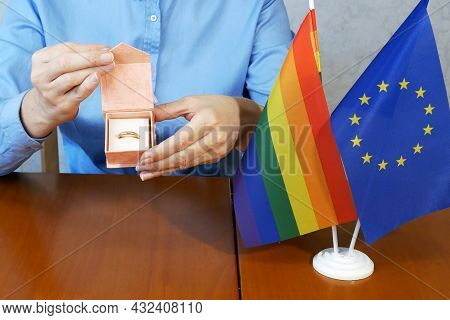 Gold Wedding Ring On Rainbow Lgbt Flag And European Union Flag. Homosexual Marriage. Same-sex Marria