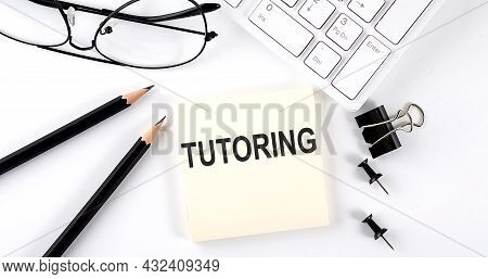 Text Tutoring On Sticker With Keyboard , Pencils And Office Tools