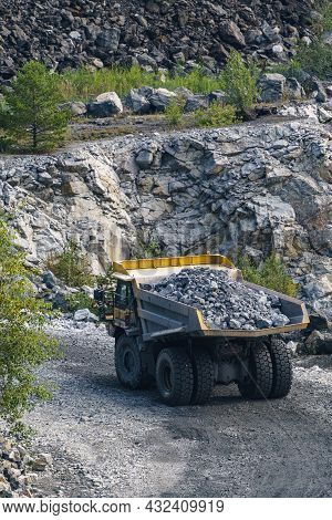 Dump Truck In Limestone Mining, Heavy Machinery. Mining In The Quarry.