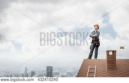 Attractive Female Construction Worker In Hardhat Standing With Folded Arms. Confident Young Woman In