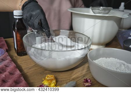 Handmade Bath Bombs Process. Preparation Of Bath Bombs. Ingredients And Floral Decor On A Wooden Vin