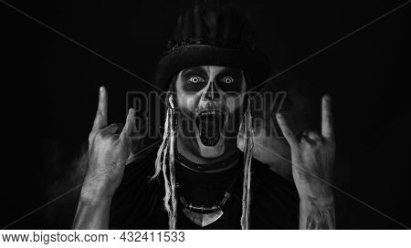Creepy Man With Skeleton Makeup In Top-hat With Feathers. Guy Wearing Earphones, Listening Music, Da