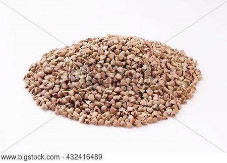 Pile Of Buckwheat Isolated On White Background. Buckwheat. Buckwheat Grains. Grain Culture.