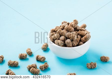 Rye Bran In A Bowl And On A Table On A Blue Background. Diet And Cleansing The Body With Fiber