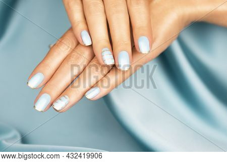 Beautiful Female Hands With Blue Manicure And Sparkles. Colored French Manicure With Sparkles.
