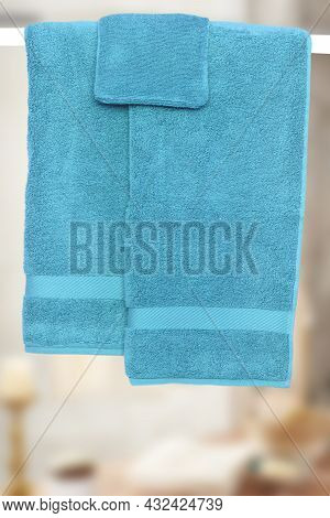 Hanging Towels. Close-up Of Various Blue Soft Terry Bath Towels Hanging On A Clothes Rail Against A