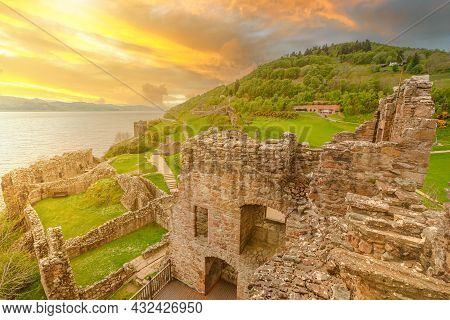 Top View Of Urquhart Castle At Sunset Beside Loch Ness In Scotland, United Kingdom. Close To Inverne