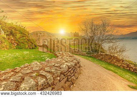 Urquhart Castle At Sunset Beside Loch Ness In Scotland, United Kingdom. Close To Drumnadrochit Villa