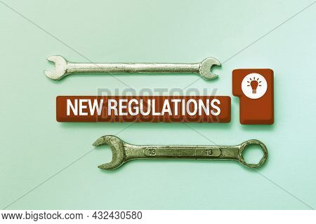 Text Sign Showing New Regulations. Business Concept Rules Made By A Government Or Authority In Order