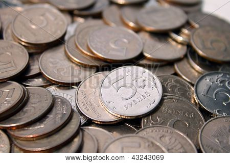 poster of handful of coins in denominations of five roubles glisten in the sun
