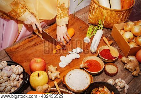 Top View Korean Women Use A Carrot Knife To Make Kimchi, A Traditional Recipe Of Korean Culture With