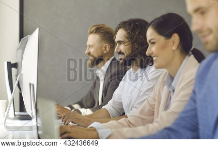 Smiling Diverse Businesspeople Work Online On Computers