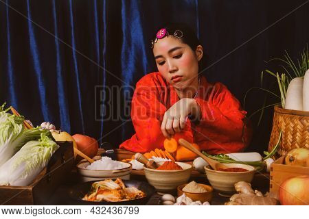 Korean Woman In Red Hanbok Has Anorexia Looking At Fresh Vegetables And Ingredients For Making Kimch