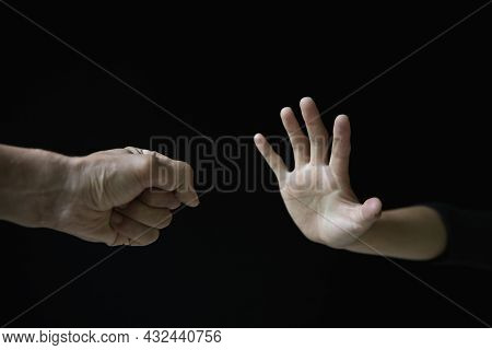 Violent Young Man Threatening His Girlfriend With His Fist. Domestic Violence Concept, Stop Violence