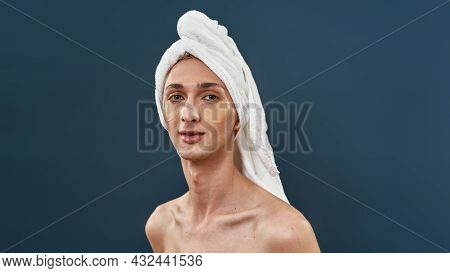 Portrait Of Naked Young Transgender With Applied Under Eye Gel Patches And Towel On Head Taking Care