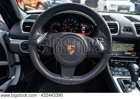 Ukraine, Odessa September 8 - 2021: Porsche 718 Boxter Steering Wheel. View Of Porsche Logo On Car S