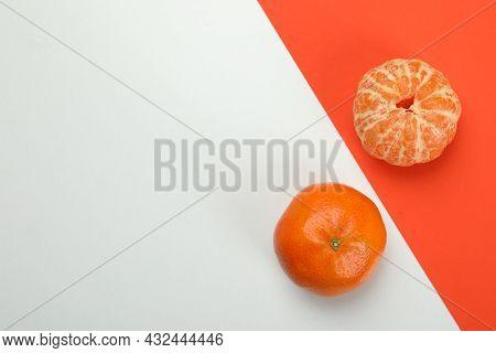 Tasty Fresh Mandarins On Two Tone Background
