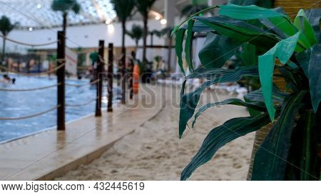 Indoors A Luxurious Indoor Swimming Pool With Blue Water And Real Golden Sand. The Concept Of Summer