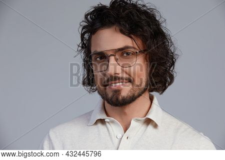 Handsome, Smiling, Young Man With Dark Long Hair And Stylish Glasses Isolated On Gray Background, In