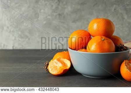 Bowl With Mandarins On Dark Wooden Table