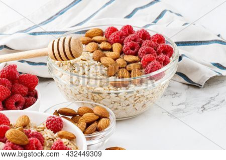 Healthy Breakfast. Bowl With Oatmeal With Fresh Raspberries And Almonds