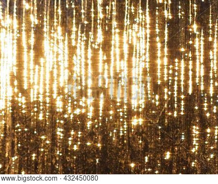 An Abstract Picture Of Golden Light Streaks On Glass