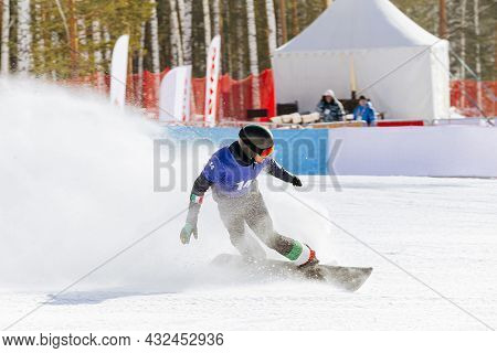 Italian Snowboard Slow Down In Finish Line Behind It Splashes Of Snow