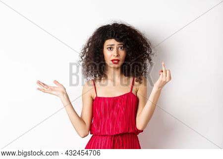Annoyed Caucasian Woman In Red Dress, Showing Finger Without Wedding Ring, Arguing About Marriage, S