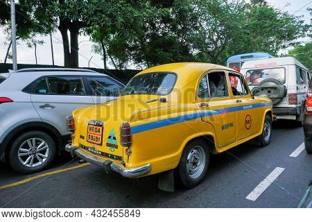 Kolkata, West Bengal, India - 20th July 2019 : Yellow Taxi On The Road, The Symbolic Icon Of Kolkata