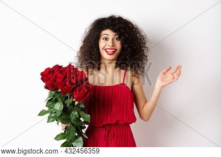 Romance And Valentines Day. Woman Gasping Surprised And Happy, Receive Surprise Gift From Lover, Hol