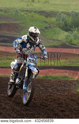 Motorsport. An Athlete On A Racing Motorcycle In The Mud. Selective Focus.