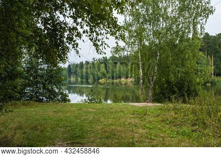 Beautiful Summer Landscape With A Small Reservoir On A Cloudy Summer Day.