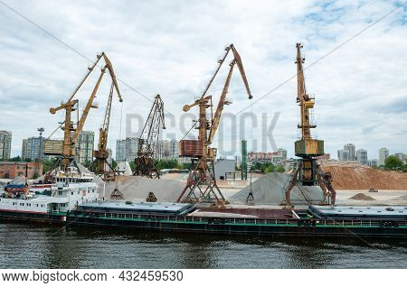Port Work Loading And Unloading The Barge With Sand And Gravel