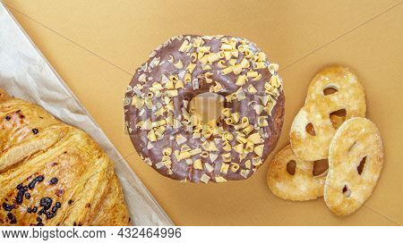 Fresh Chocolate Donut, Croissant And Biscuit Isolated On Delicate Coffee Or Brown Background. Delici