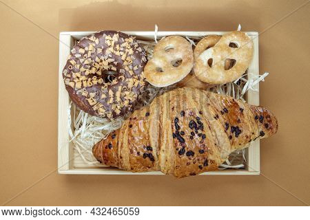Fresh Chocolate Donut, Croissant And Cookies Isolated On Delicate Coffee Or Brown Background. Delici