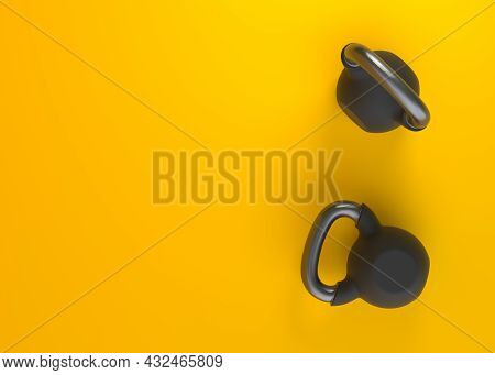 Black Kettlebells On Yellow Background. Heavy Weights. Gym And Fitness Equipment. Workout Tools. Mus