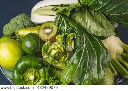 Assortment Of Green Fresh Superfood. Healthy Food. Avocados, Broccoli, Kiwi And Other Green Vegetabl