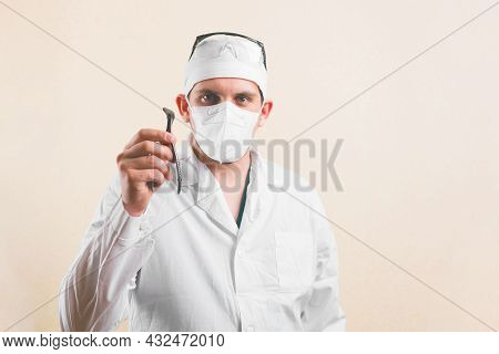 Young Doctor In White Lab Coat, Protective Glasses And Protective Breathing Mask With Medical Exam T