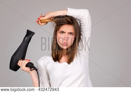 Woman With Hair Dryer. Beautiful Girl With Straight Hair Drying Hair With Professional Hairdryer. Ha