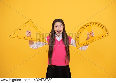 Surprised Kid Girl Use Protractor And Triangle To Learn Mathematics, Measurement