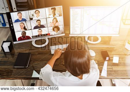 Virtual Conference With Agenda On Multiple Monitor Computer In Office